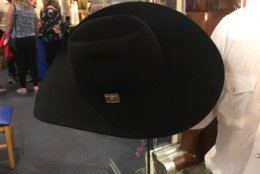 The hat is made of felt, has a gold buckle with a diamond, ruby and sapphire in it. (WTOP/Dick Uliano)