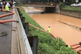 DC Water crews worked to clear a flooded underpass Monday. (Courtesy DC Water)