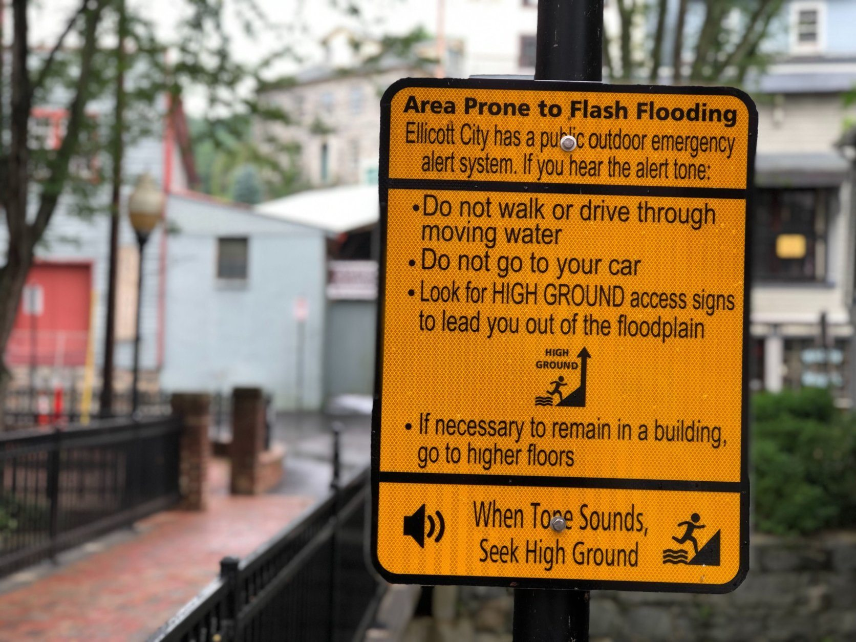 These signs are posted up along a waterway in Ellicott City, Maryland. (WTOP/Kate Ryan)