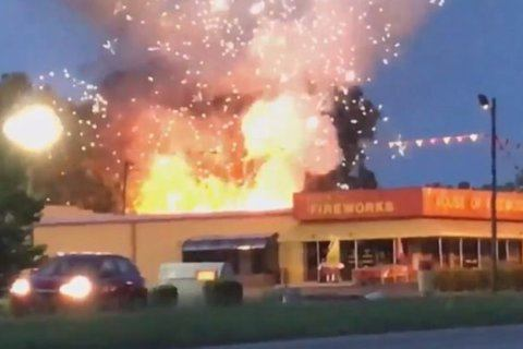 Firefighters get premature 4th of July show after containers at fireworks store explode