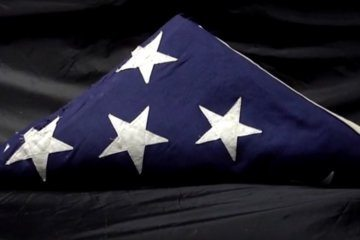 Police search for owners of flag found on Prince George's Co. road