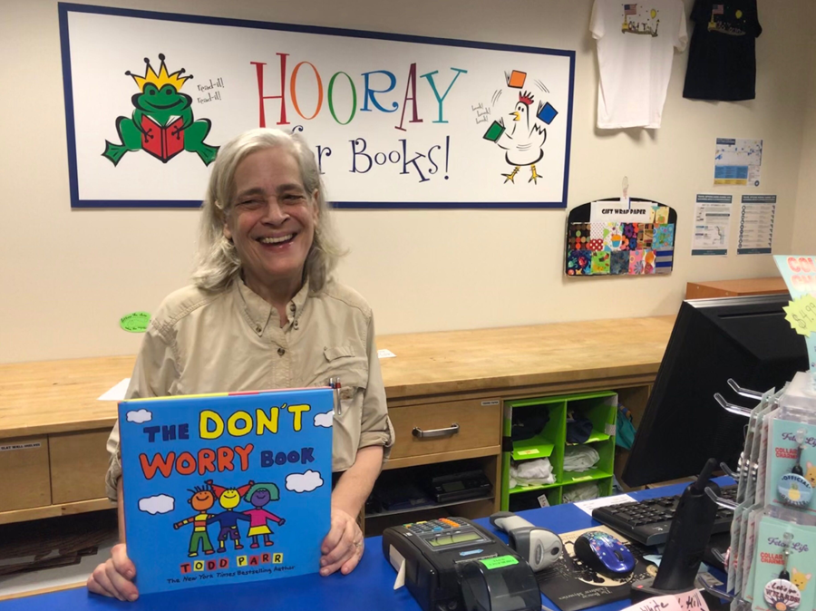 """Ellen Klein, owner of Hooray for Books, is pressing on after the damage. """"We already have customers who are getting book drives going. We have customers who've said they'll volunteer their time,"""" she said. """"I'm sure we're going to need that help when we put things back where they belong."""" (WTOP/Kristi King)"""