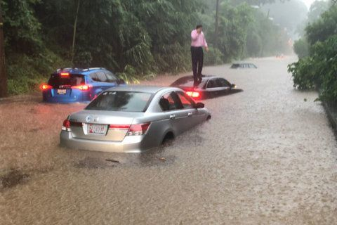Roads become rivers, drivers swim to safety in DC flood emergency