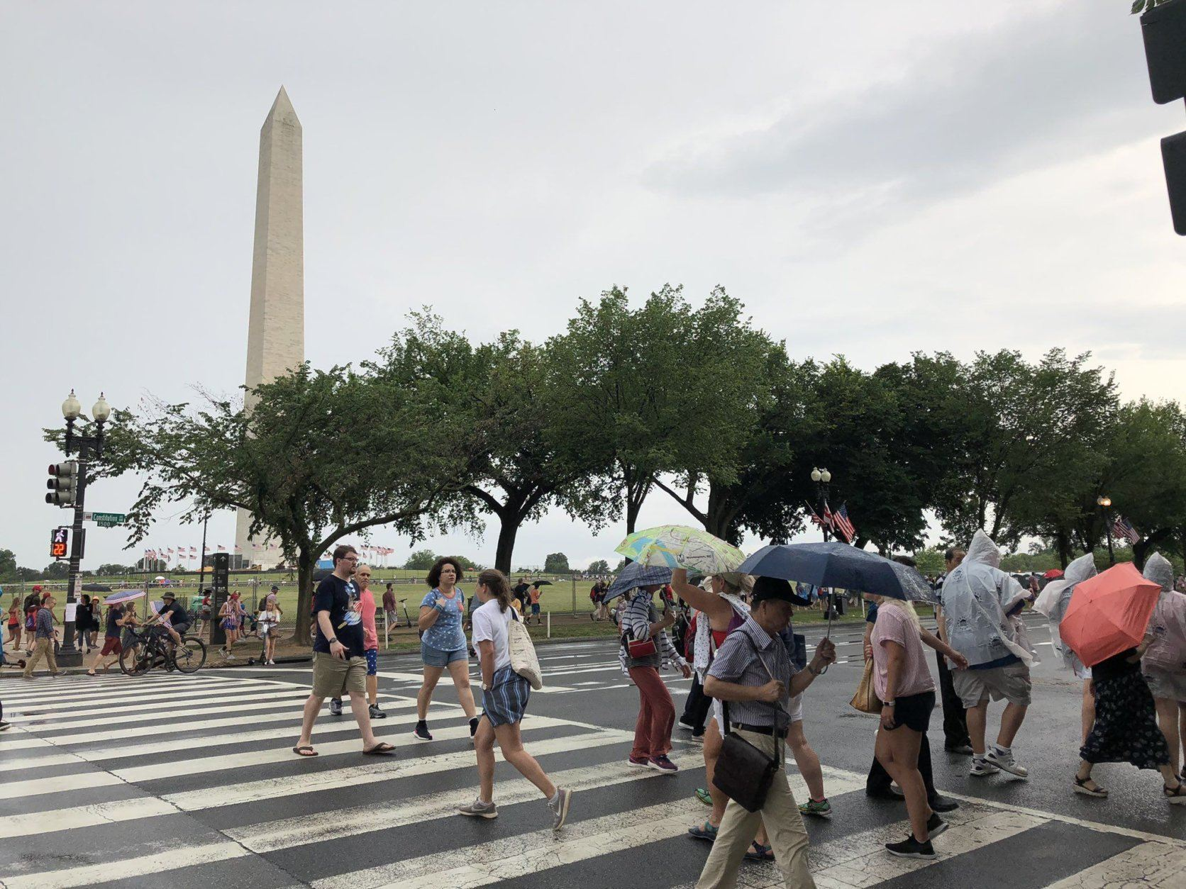 People walk around 15th Street and Constitution Avenue by the National Mall on Thursday, July 4, 2019. (WTOP/Michelle Basch)