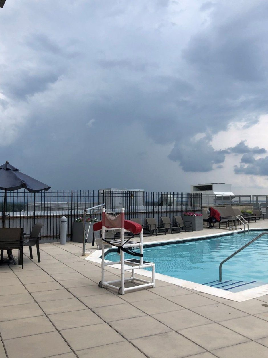 Here's a view of storm clouds from a D.C.-area rooftop pool on Thursday, July 4, 2019. (Courtesy @snazzzyredhead via Twitter)