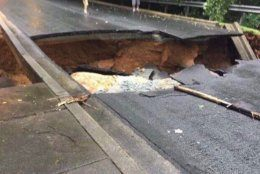 In Potomac, Maryland, a sinkhole blocked Belfast Road near Macarthur Boulevard. (Courtesy Montgomery County Fire and EMS Department)