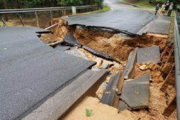 a sinkhole blocked Belfast Road near Macarthur Boulevard.