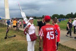 A protester and Trump supporters engage in a conversation during the July Fourth activities at the National Mall. (WTOP/Mike Murillo)