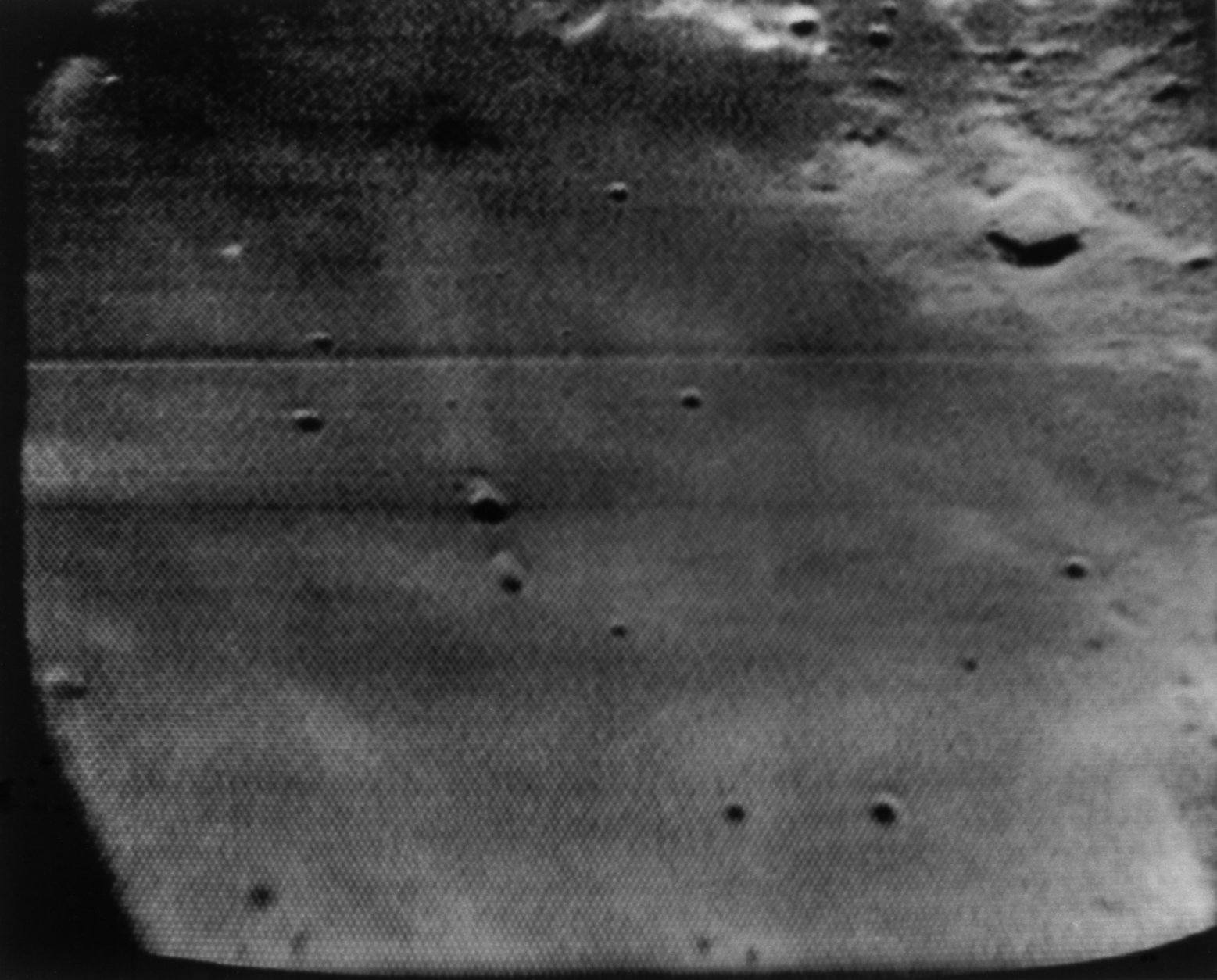This is the Apollo 11 primary landing site as seen from the hatch window of the spacecraft and telecast back to earth on July 19, 1969. (AP Photo/NASA)