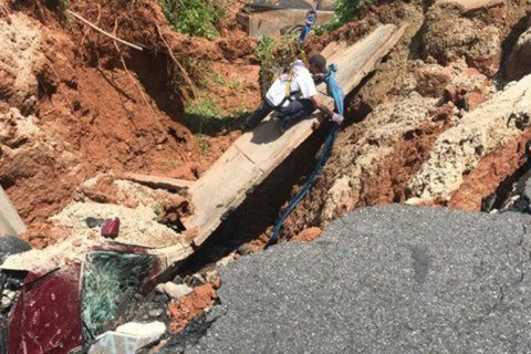 Massive sinkhole swallows car in Woodbridge, road closed indefinitely