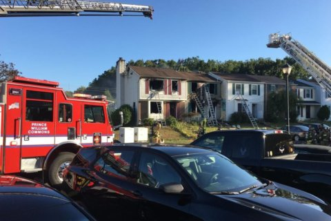 Four townhouses damaged, three injured in Woodbridge fire