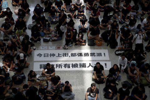 Mob violence marks 2nd day of protests at Hong Kong airport