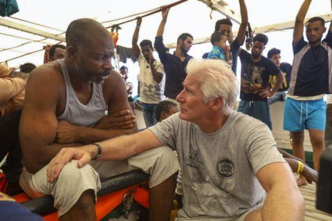 Richard Gere visits migrants stuck in the Mediterranean