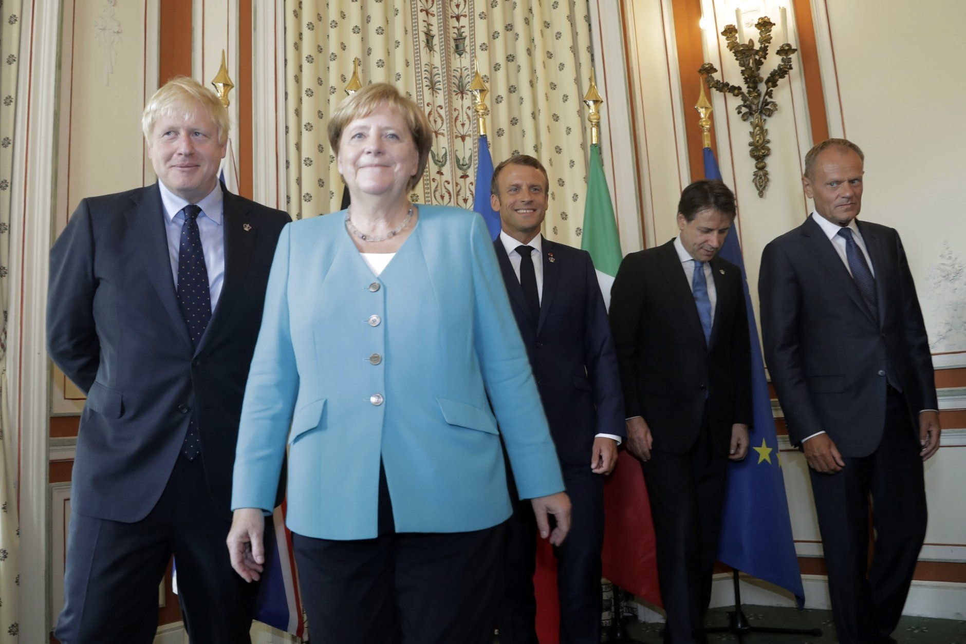 From the left, Britain's Prime Minister Boris Johnson, German Chancellor Angela Merkel, French President Emmanuel Macron, Italian Premier Giuseppe Conte and President of the European Council Donald Tusk pose during a G7 coordination meeting with the Group of Seven European members at the Hotel du Palais in Biarritz, southwestern France, Saturday, Aug.24, 2019. Efforts to salvage consensus among the G-7 rich democracies frayed Saturday in the face of U.S. President Donald Trump's unpredictable America-first approach even before the official start of the summit in southern France. (AP Photo/Markus Schreiber, Pool)