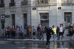 A protestor throws a rock at police in Bayonne, France, Saturday, Aug. 24, 2019. World leaders and protesters are converging on the southern French resort town of Biarritz for the G-7 summit. Police have fired water cannon at about 400 anti-capitalist protesters blocking roads in a town near the venue of the G-7 summit. A few protesters threw rocks at police but the crowd in Bayonne was largely peaceful. (AP Photo/Emilio Morenatti)