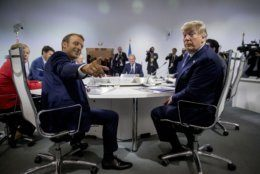 French President Emmanuel Macron, left, and President Donald Trump, right, participates in a G-7 Working Session on the Global Economy, Foreign Policy, and Security Affairs the G-7 summit in Biarritz, France, Sunday, Aug. 25, 2019. (AP Photo/Andrew Harnik, Pool)