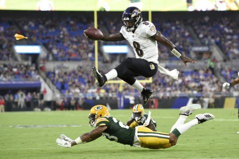 Jackson looks sharp, Rodgers sits as Ravens beat Packers