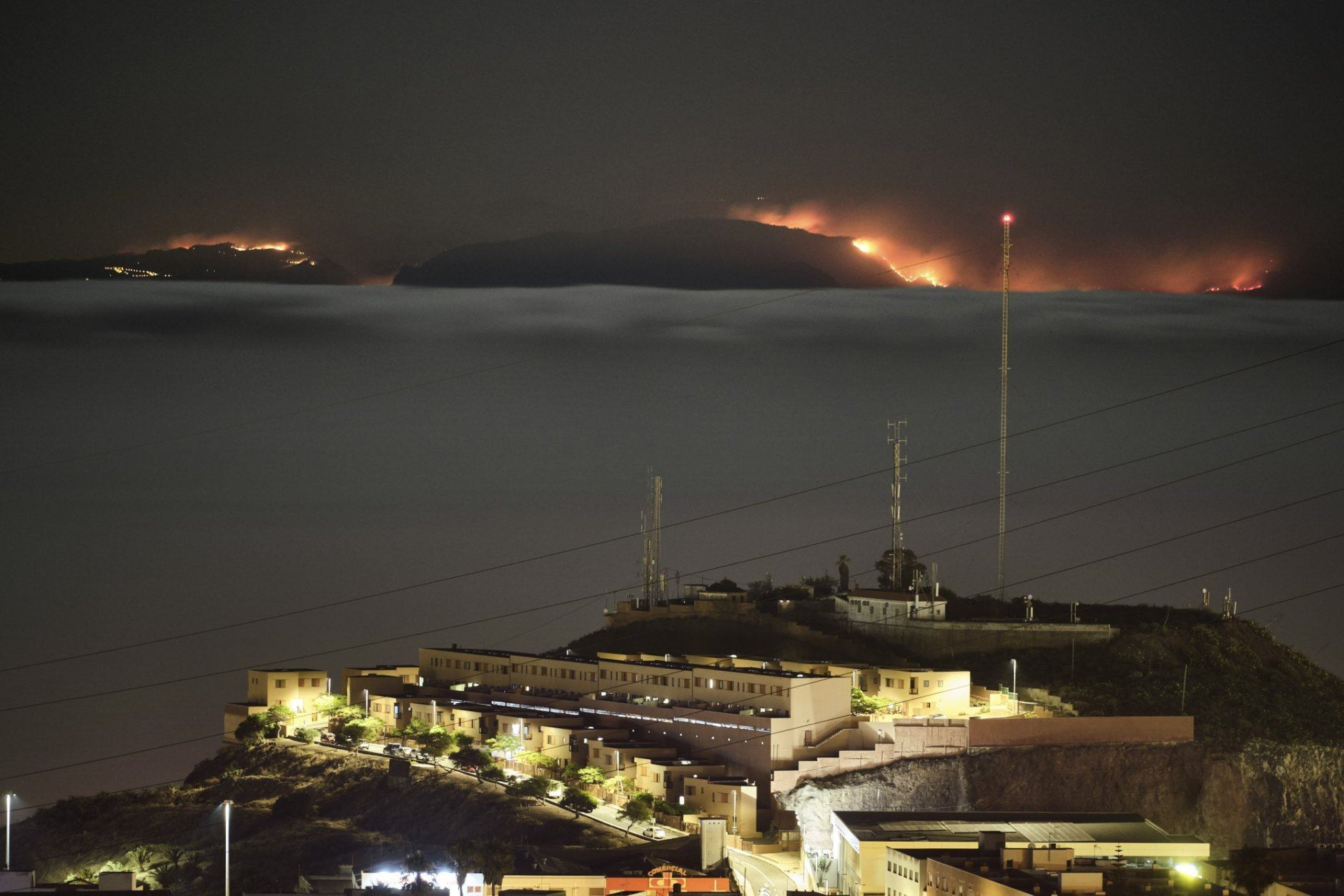 <p>The fire on the mountains of the Canary Islands in this view taken from Santa Cruz de Tenerife island, Spain, early Monday, Aug. 19, 2019. Authorities on Spain&#8217;s Canary Islands say around 4,000 people have been evacuated due to a wildfire that has ravaged more than 1,700 hectares (4,200 acres) since it broke out a day ago. (AP Photo/Andres Gutierrez)</p>