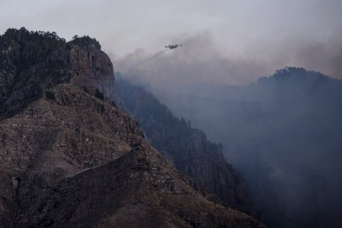 Spain: Island wildfire eases, lets evacuees return home