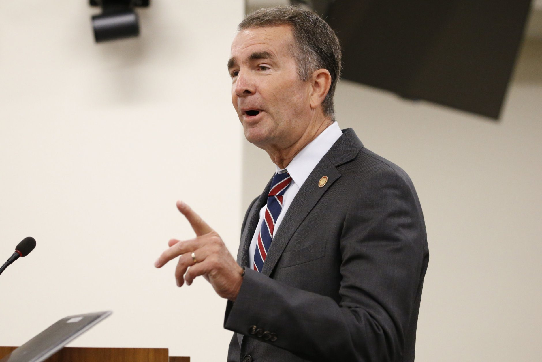 Virginia Gov. Ralph Northam gestures as he delivers his budget update before a joint meeting of the House and Senate money committees at the Capitol in Richmond, Va., Tuesday, Aug. 20, 2019. (AP Photo/Steve Helber)