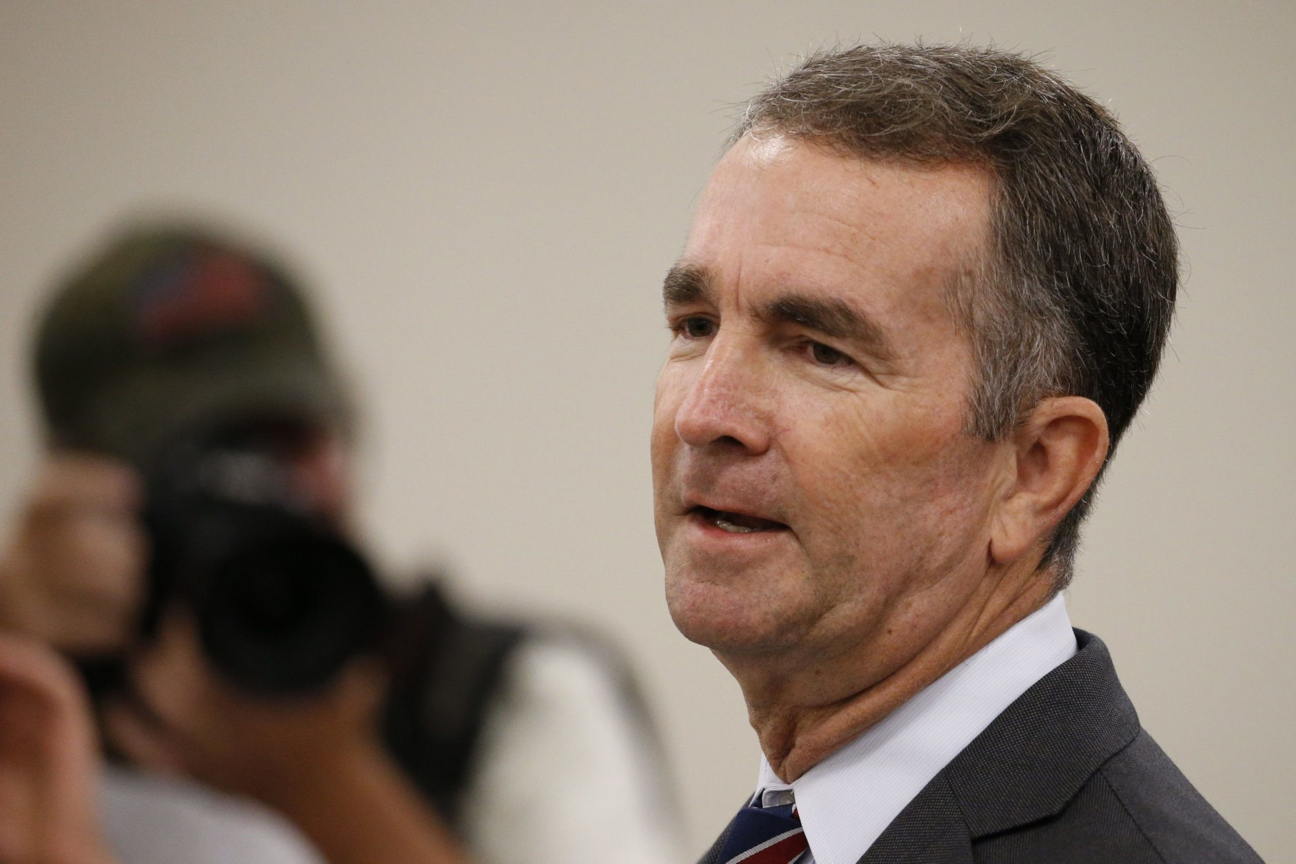 Virginia Gov. Ralph Northam delivers his budget update before a joint meeting of the House and Senate money committees at the Capitol in Richmond, Va., Tuesday, Aug. 20, 2019. (AP Photo/Steve Helber)