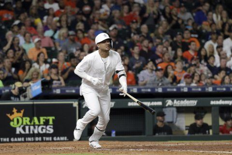 Greinke wins again as Astros get 5-4 victory over Angels