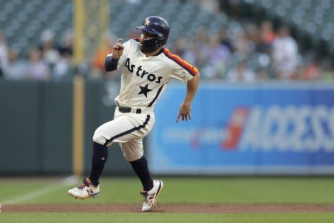 Miley helps Astros beat Orioles 3-2 for 7th straight victory