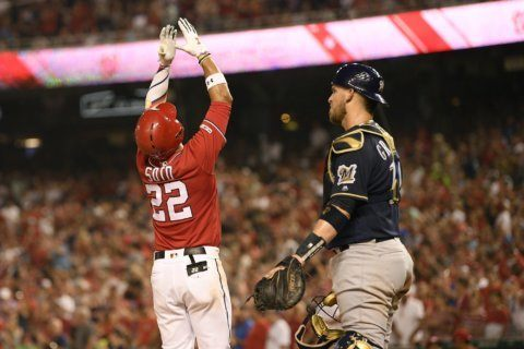 Thames' HR in 14th, Yelich's 2 help Brewers beat Nats 15-14