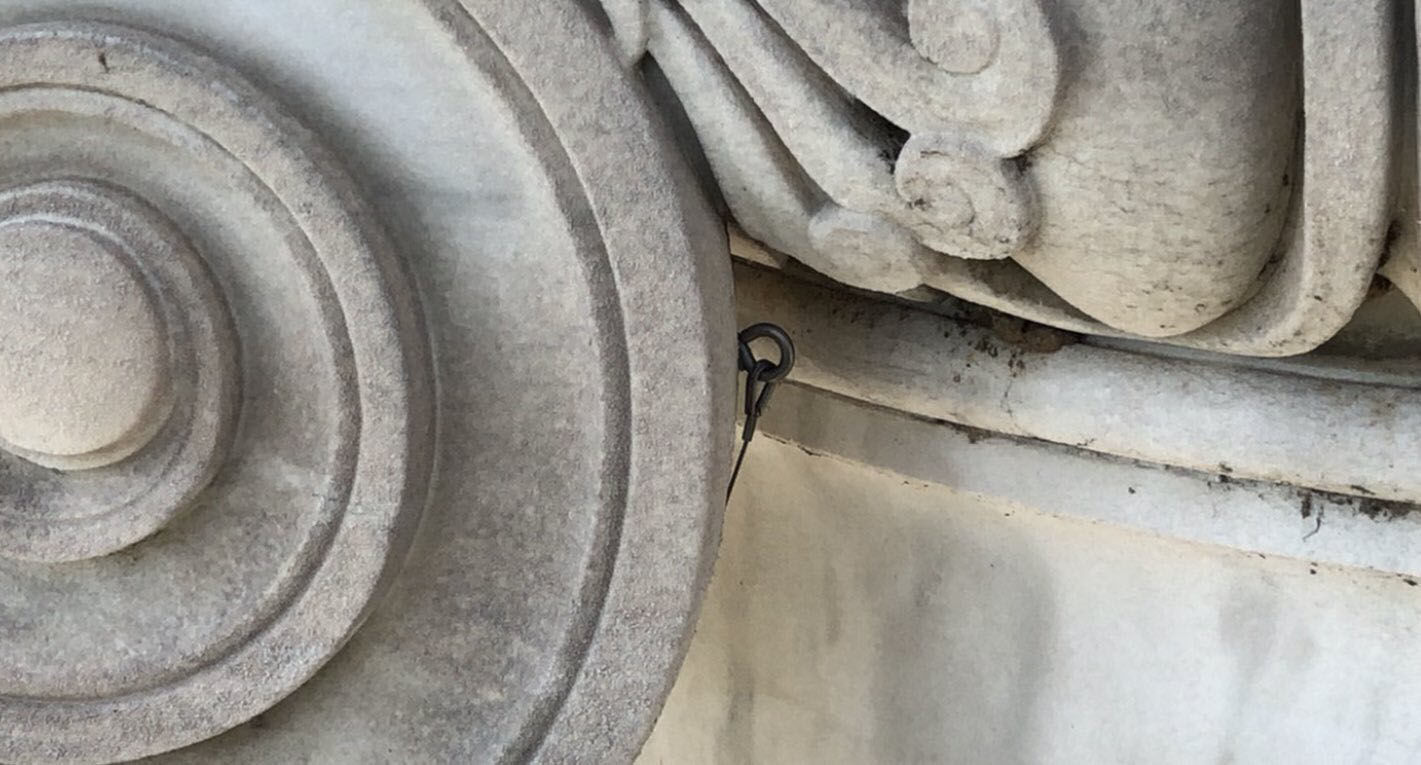 """<p>Some of the capitals of the memorial&#8217;s<a href=""""https://www.aoc.gov/capitol-hill/architecture-columns/ionic-columns"""" target=""""_blank"""" rel=""""noopener"""">ionic columns</a> are awkward to access, and have experienced stone failure in the past. They&#8217;ve been anchored into place with wires that now need to be tightened.</p> <p>The panels that create the front triangle-shaped portico roof weigh between 700 and 1,200 pounds each. They&#8217;ll eventually be removed, taken to the ground, restored and replaced after the flat surface underneath has been upgraded and waterproofed.</p>"""
