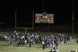 Players and fans of Paradise High School mill on the field after defeating Williams High School 42-0 in Paradise, Calif., Friday, Aug. 23, 2019. This was the first game for the school since a wildfire last year that killed dozens and destroyed nearly 19,000 buildings including the homes of most of the players. (AP Photo/Rich Pedroncelli)