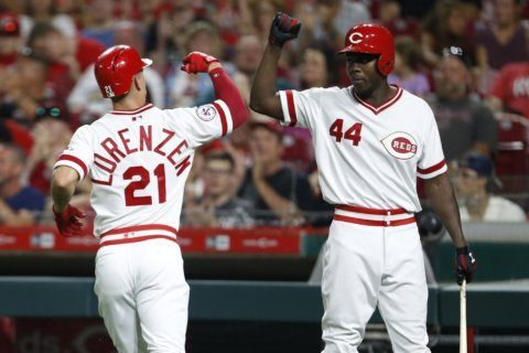 Aquino, Reds drop Cards into first-place tie with 6-1 win