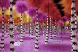 """This undated rendering provided by Dr. Seuss Enterprises shows a grove of Truffula trees, from Seuss' book """"The Lorax,"""" that will be incorporated as part of a touring immersive attraction tied to the work of the famous late author and illustrator of children's books. The exhibit is scheduled debut in Toronto in October 2019, followed by visits to several cities in the United States. (Kilburn Experiences, LLC/Dr. Seuss Enterprises via AP)"""