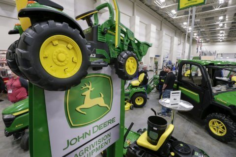 Flooding, a trade war and Deere cuts outlook again