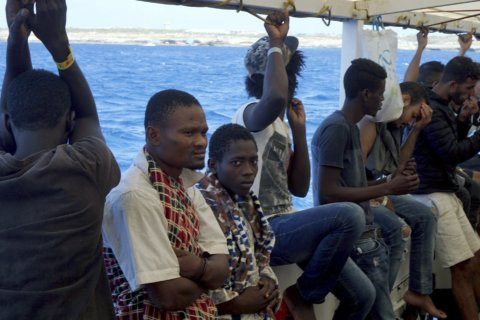Charity suggests plane could resolve migrant boat standoff