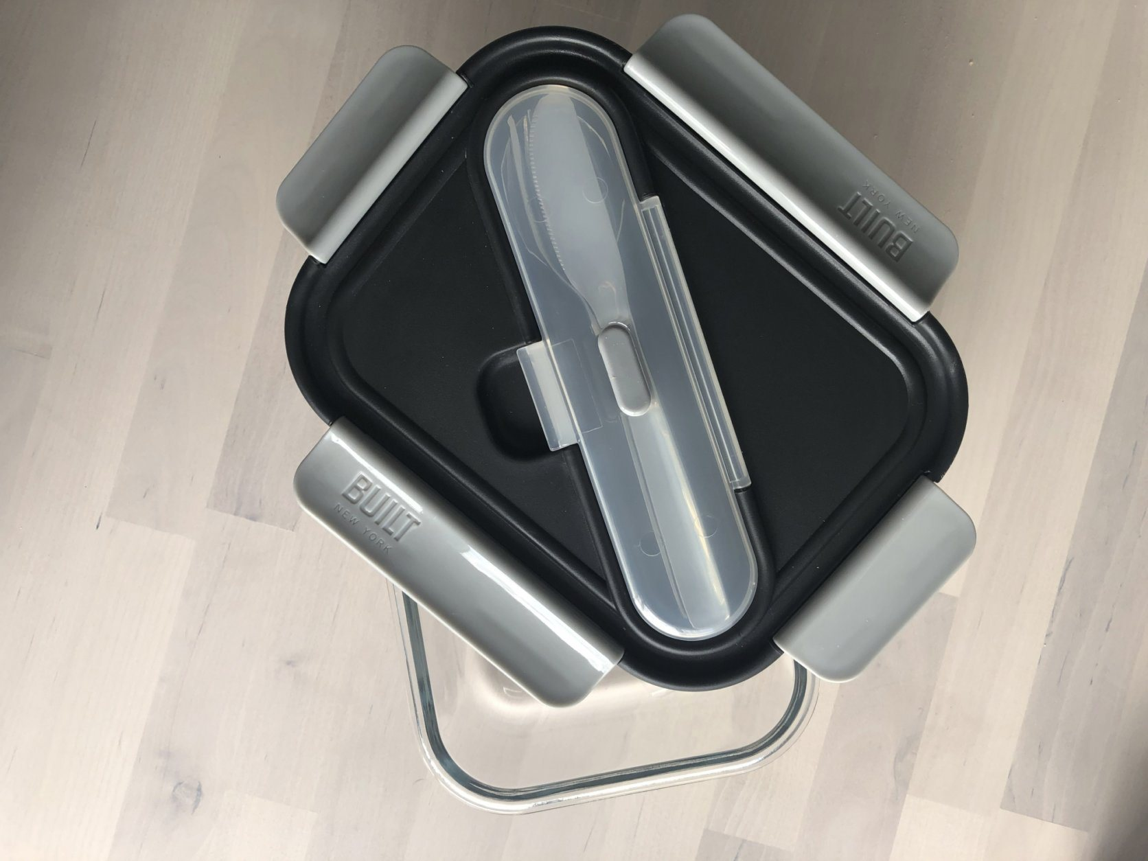 This 2019 photo taken in New York shows a glass lunch bento box with stainless steel utensils from Built. (Katie Workman via AP)