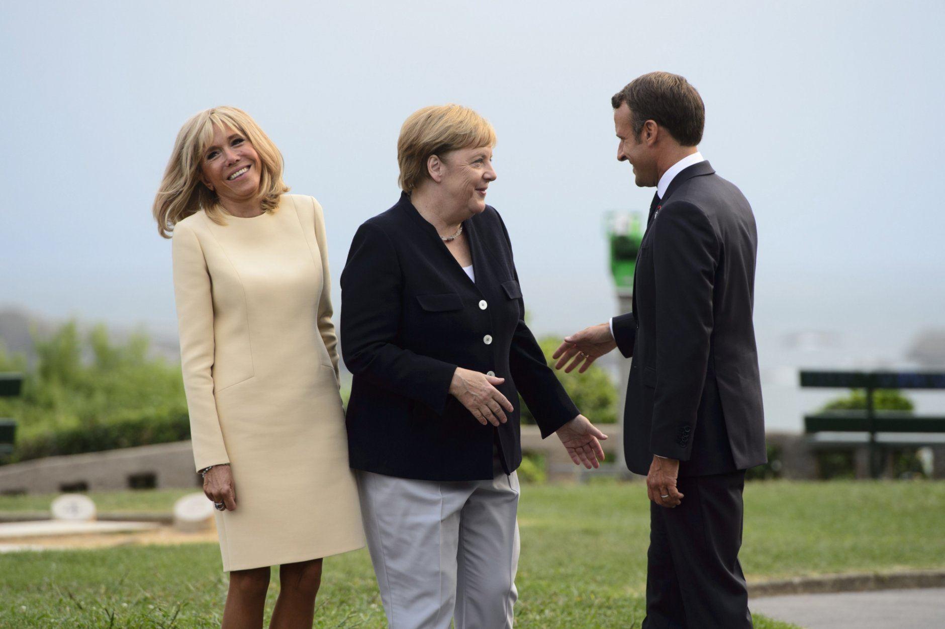 Emmanuel Macron, Brigitte Macron, Angela Merkel