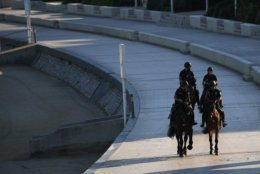 Mounted police officers patrol along the beach, Saturday, Aug. 24, 2019 in Biarritz. Leaders of the Group of Seven countries arrive on Saturday to discuss issues including the struggling global economy and climate change until Monday. They include the United States, Germany, Japan, Britain, France, Canada and Italy. (AP Photo/Francois Mori)