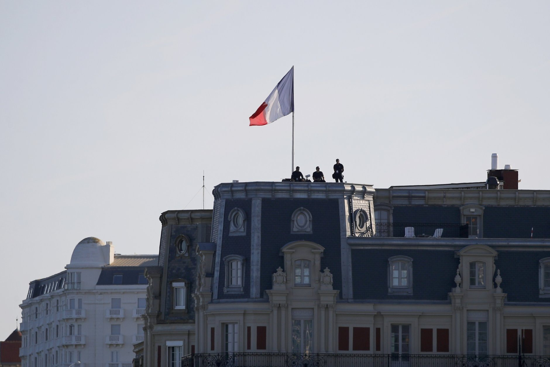 Police forces stand atop a building roof Saturday, Aug. 24, 2019 in Biarritz. Leaders of the Group of Seven countries arrive on Saturday to discuss issues including the struggling global economy and climate change until Monday. They include the United States, Germany, Japan, Britain, France, Canada and Italy. (AP Photo/Francois Mori)