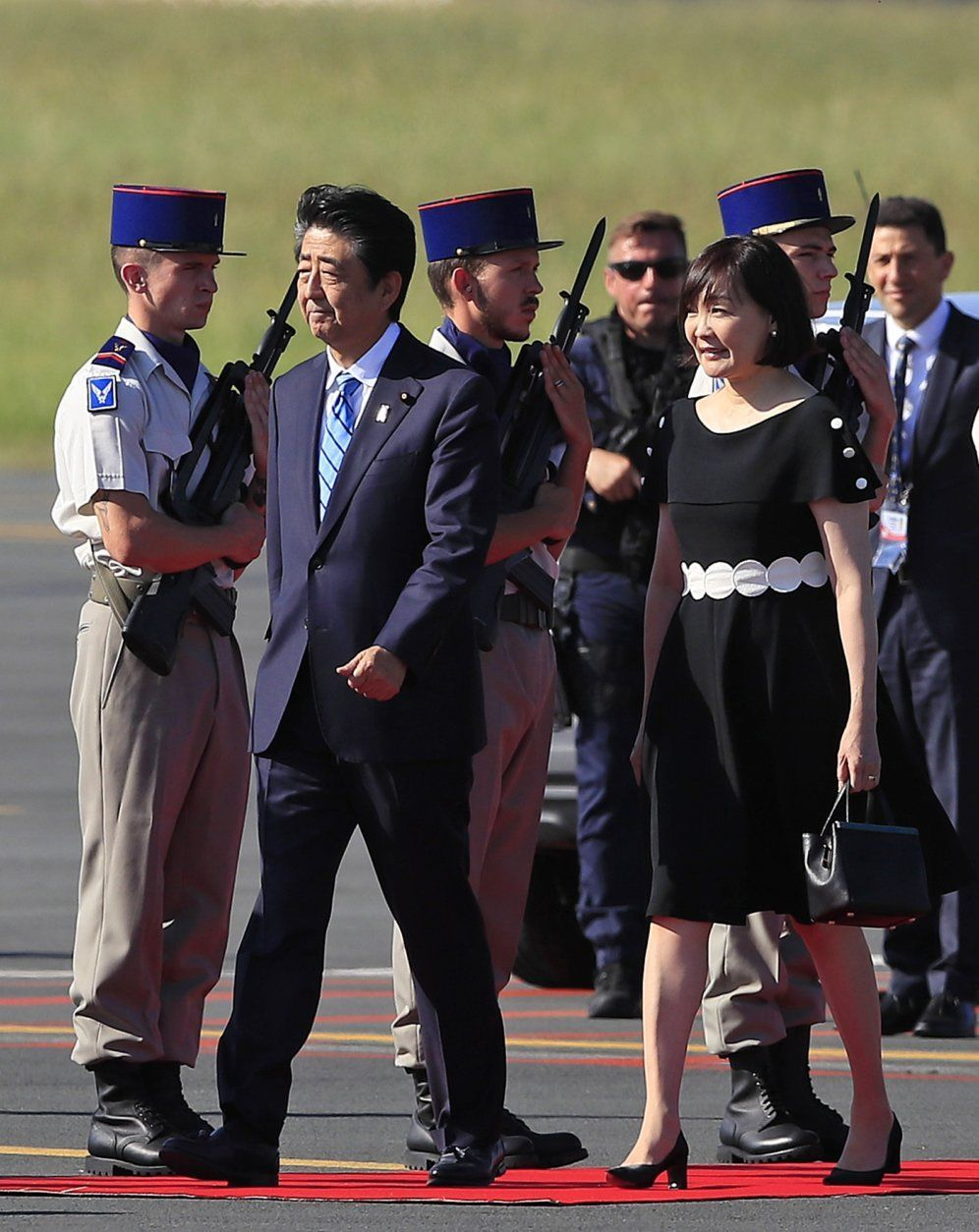 Japanese Prime Minister Shinzo Abe and his wife Akie Abe arrive at the airport in Biarritz, France, for the first day of the G-7 summit, Saturday, Aug. 24, 2019. U.S. President Donald Trump and the six other leaders of the Group of Seven nations will begin meeting Saturday for three days in the southwestern French resort town of Biarritz. France holds the 2019 presidency of the G-7, which also includes Britain, Canada, Germany, Italy and Japan. (AP Photo/Peter Dejong)