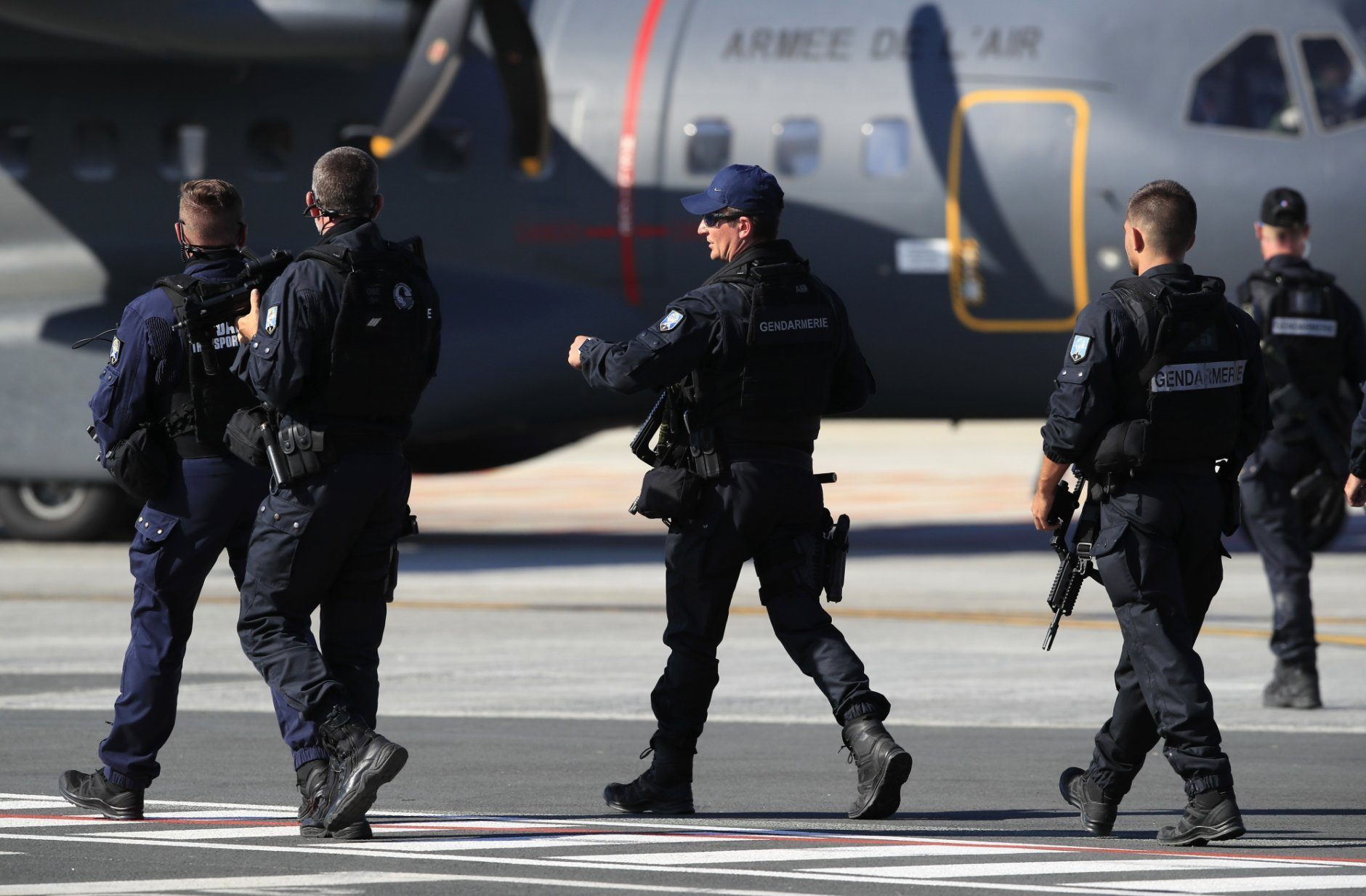 Armed police officers await the arrival of Japanese Prime Minister Shinzo Abe at the airport in Biarritz, France, for the first day of the G-7 summit, Saturday, Aug. 24, 2019. U.S. President Donald Trump and the six other leaders of the Group of Seven nations will begin meeting Saturday for three days in the southwestern French resort town of Biarritz. France holds the 2019 presidency of the G-7, which also includes Britain, Canada, Germany, Italy and Japan. (AP Photo/Peter Dejong)