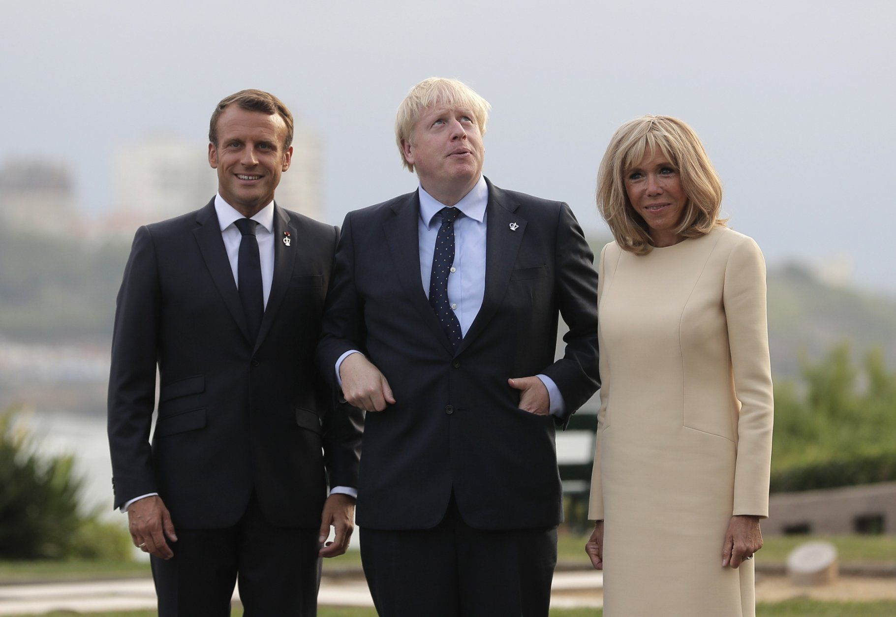 French President Emmanuel Macron and his wife Brigitte welcome Britain's Prime Minister Boris Johnson at the Biarritz lighthouse, southwestern France, ahead of a working dinner Saturday, Aug.24, 2019. Shadowed by the threat of global recession, a U.S. trade war with China and the possibility of one against Europe, the posturing by leaders of the G-7 rich democracies began well before they stood together for a summit photo. (AP Photo/Markus Schreiber)