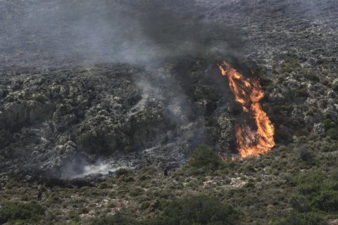 Tourists evacuated from Greek island camp as wildfire rages