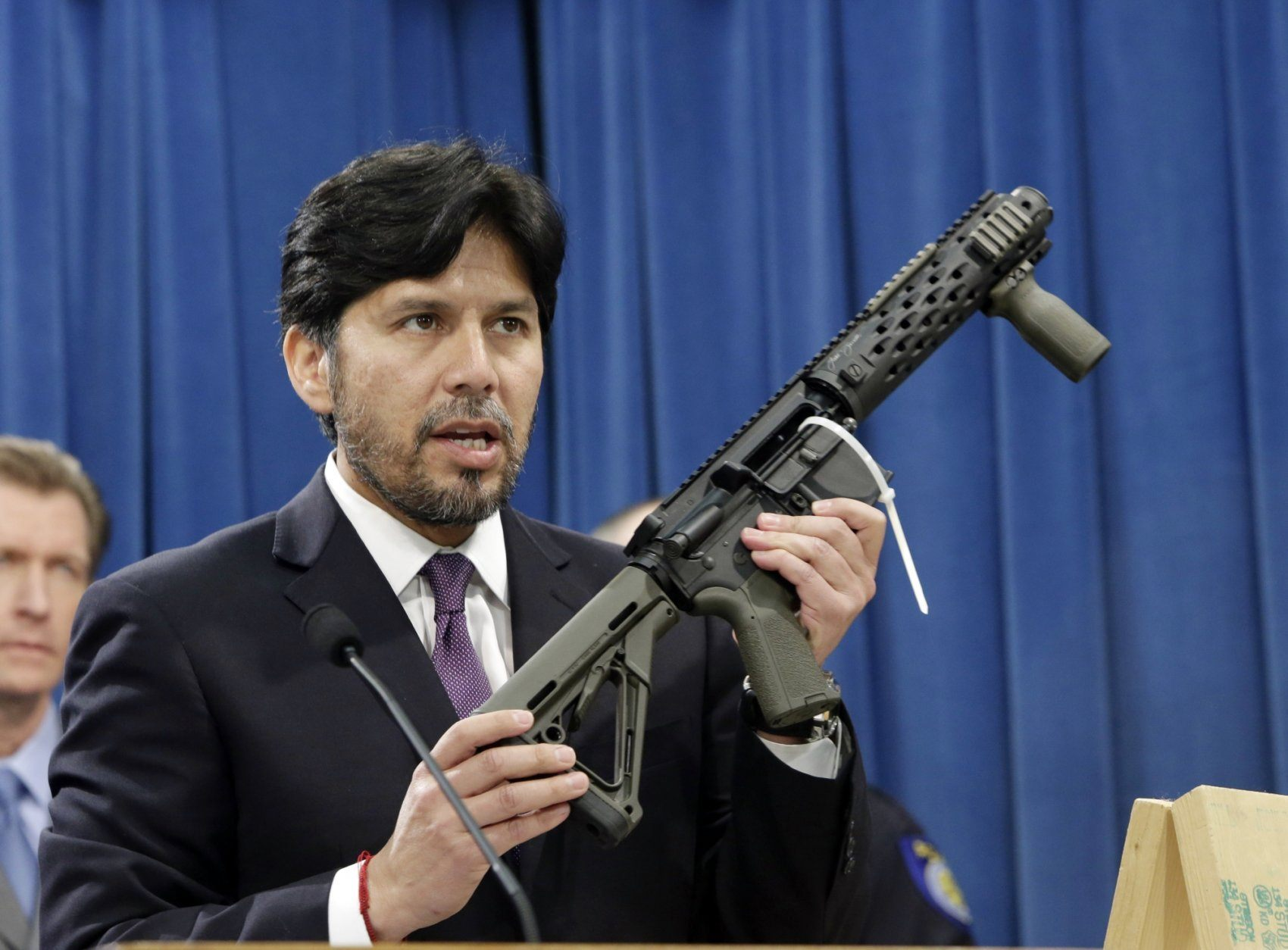 FILE - In this Jan. 13, 2014 file photo, former California State Sen. Kevin de Leon, D-Los Angeles, displays a homemade fully automatic rifle, confiscated by the Department of Justice, at the Capitol in Sacramento, Calif. California is among a handful of states taking tough actions to limit the availability of guns including military-style assault weapons, restrict the capacity of ammunition magazines and require background checks for purchasing bullets. But those steps and future gun control laws passed by Democratic-leaning states could face an uphill battle as the federal court system becomes increasingly dominated by conservative Republican appointees.(AP Photo/Rich Pedroncelli, File)