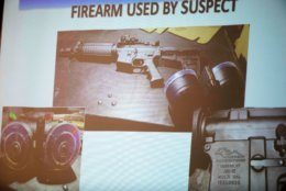 The firearm used by the shooter Connor Betts, 22, is projected on a screen during a news conference Sunday, Aug. 4, 2019, about a fatal mass shooting along the 400 block of E. Fifth Street, in Dayton, Ohio. California has some of the toughest gun laws in the nation, including a ban on the type of high-capacity ammunition magazines used in the nation's three most recent public shootings, which claimed nearly three dozen lives. How long those types of laws will stand is a growing concern among gun control advocates in California and elsewhere. (Albert Cesare/The Cincinnati Enquirer via AP)