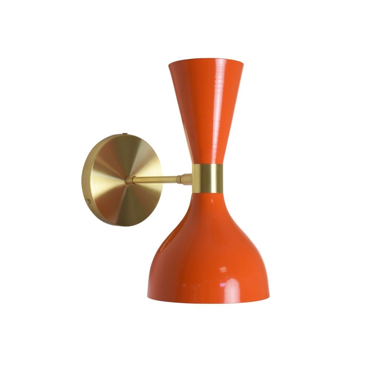<p>This undated photo shows Blueprint Lighting&#8217;s Ludo wall sconce. The shape of a wine glass inspired the sconce in tangerine is shown here. The fixture&#8217;s terracotta-hued enameled finish contrasts nicely with the articulating brass arm. Terracotta blends well with many metal tones and finishes. (Blueprint Lighting via AP)</p>