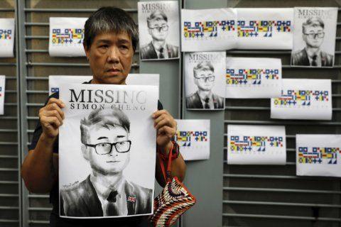 China says British consulate staffer detained 15 days