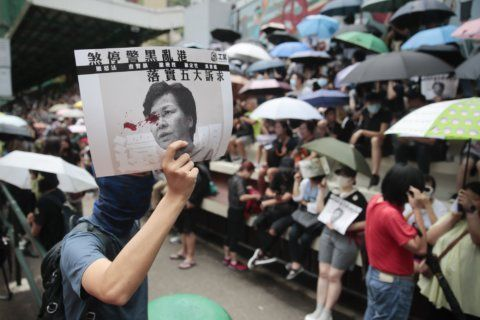 The Latest: Hong Kong police storm subway car with batons