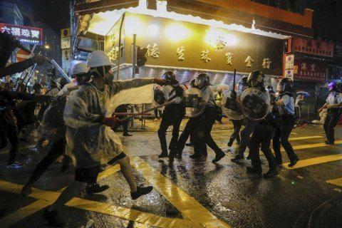 Tear gas, warning shot mark escalation in Hong Kong protests