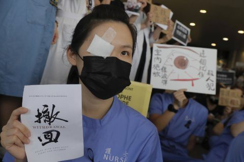 AP PHOTOS: HK protesters show solidarity with injured woman