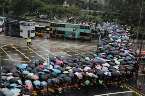 Hong Kong's divide: Protests for democracy, rally for China